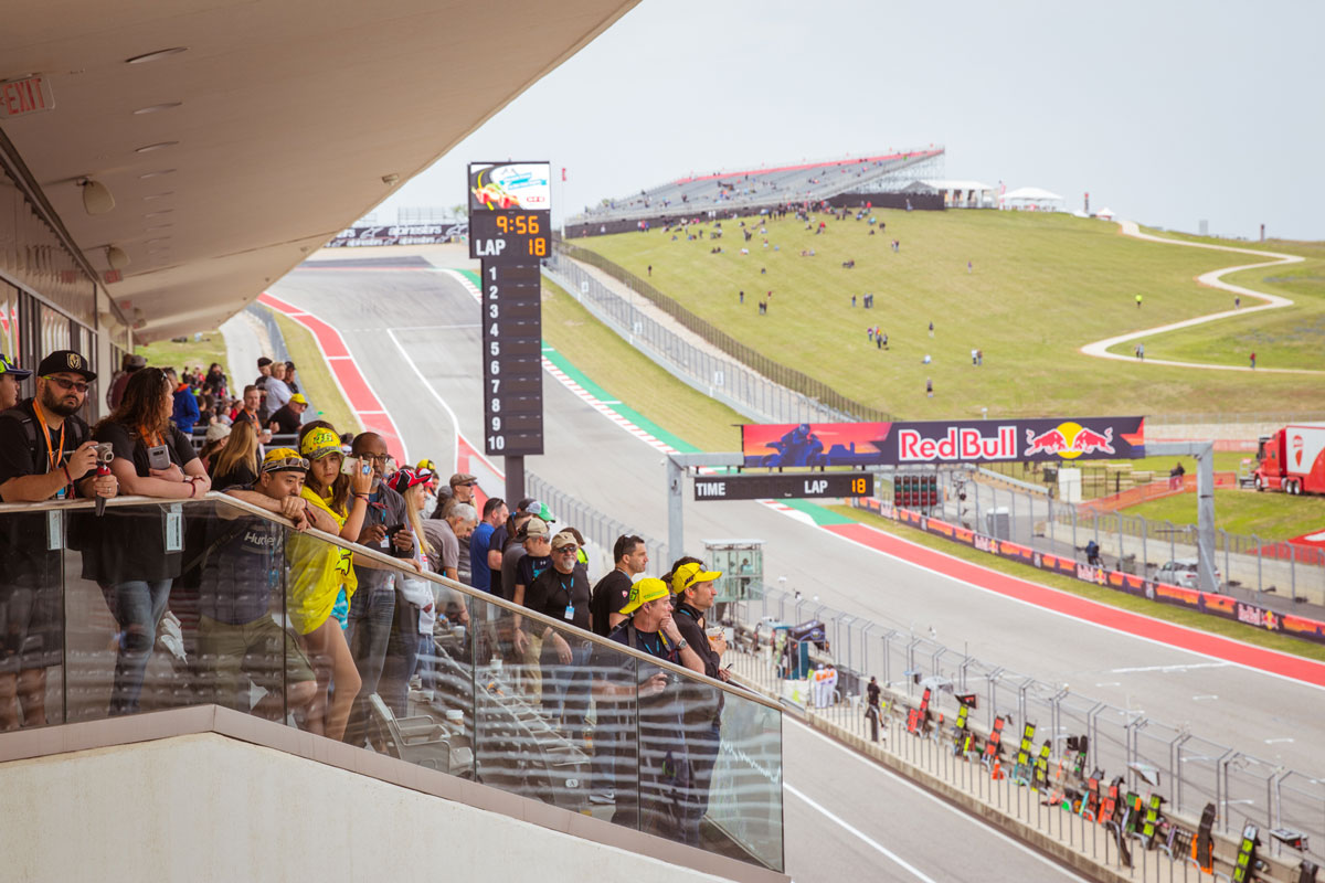 Motogp Austin crowd in the paddock building