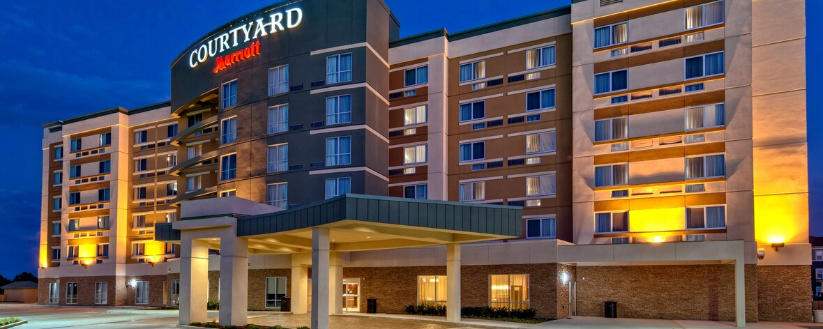 exterior of Courtyard Westbury belmont experiences accommodations