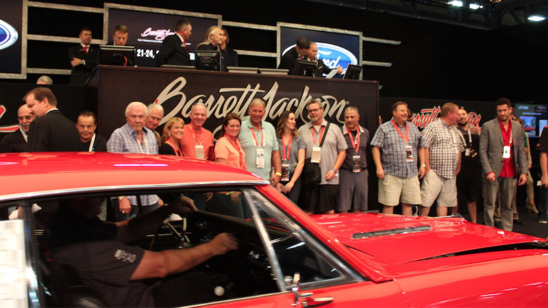 red car at barrett jackson