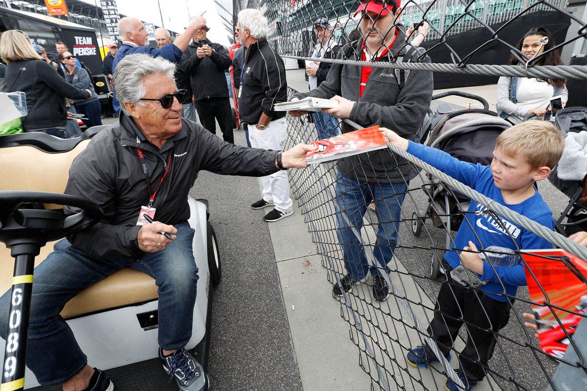 Mario Andretti with fan