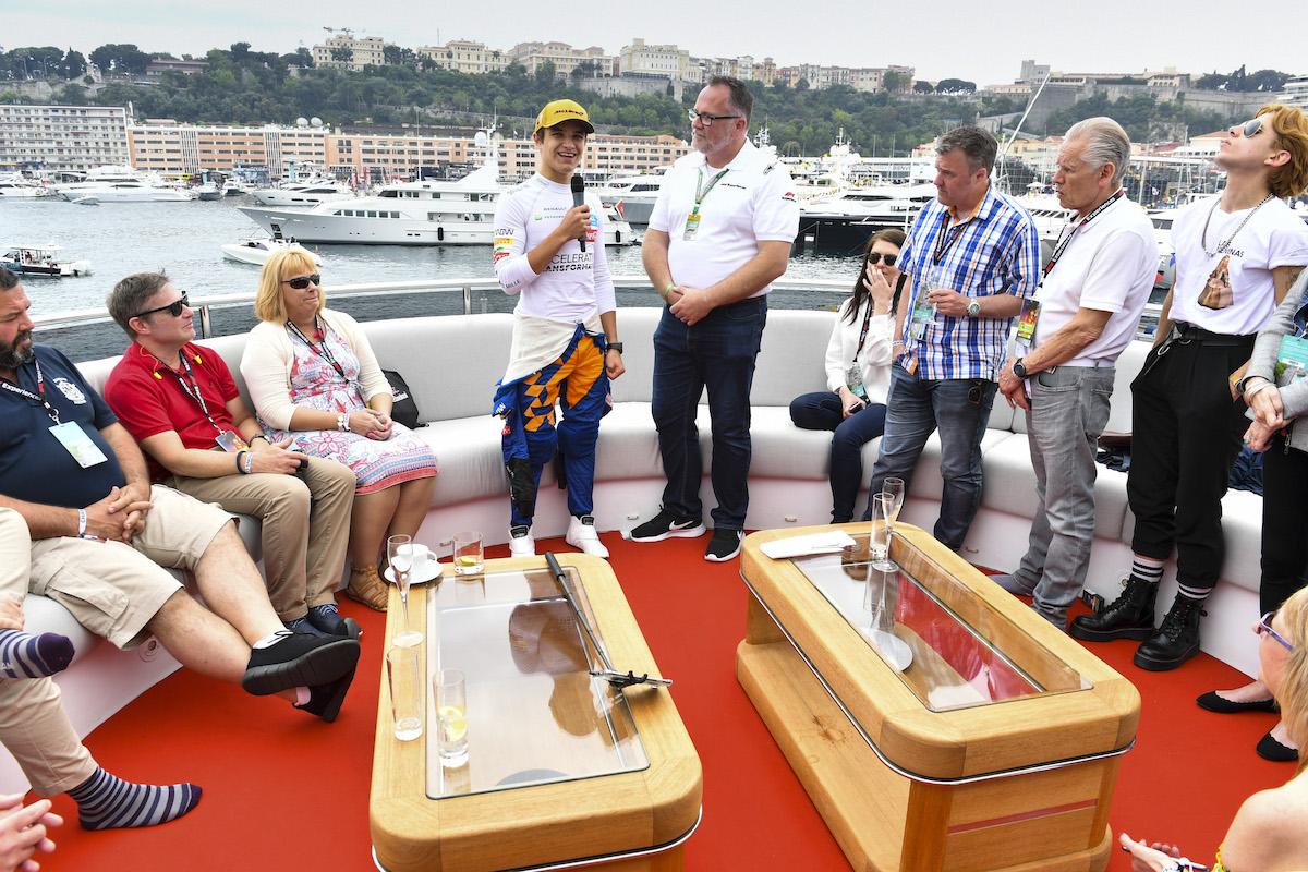 Lando Norris trackside yacht Monaco Grand Prix