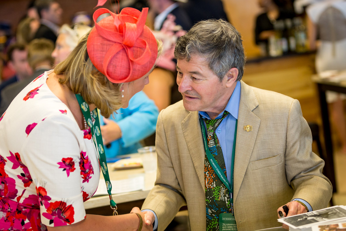 two people shaking hands at belmont experiences hospitality
