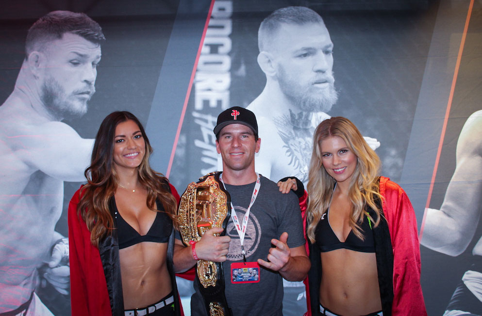 photo opp with championship belt and Octagon Girls