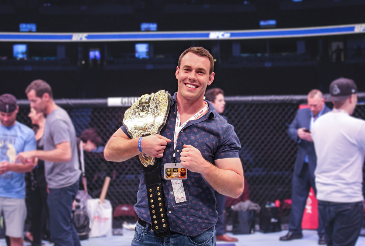 Photo in the octagon with the Championship belt during UFC Octagon Experience