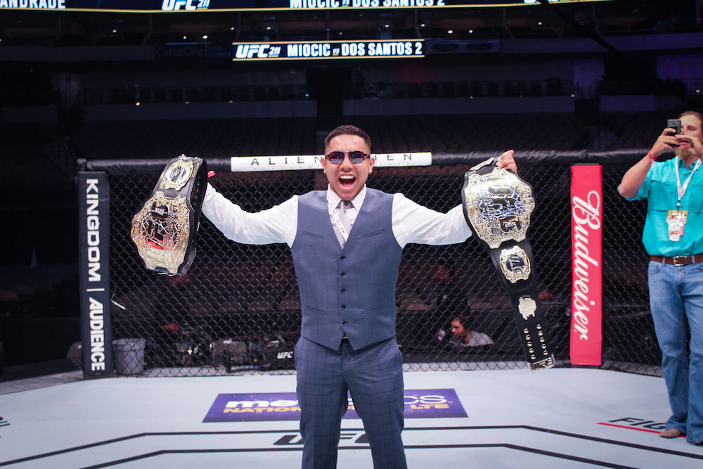Photo with the Championship belt in the Octagon during UFC Octagon Experience