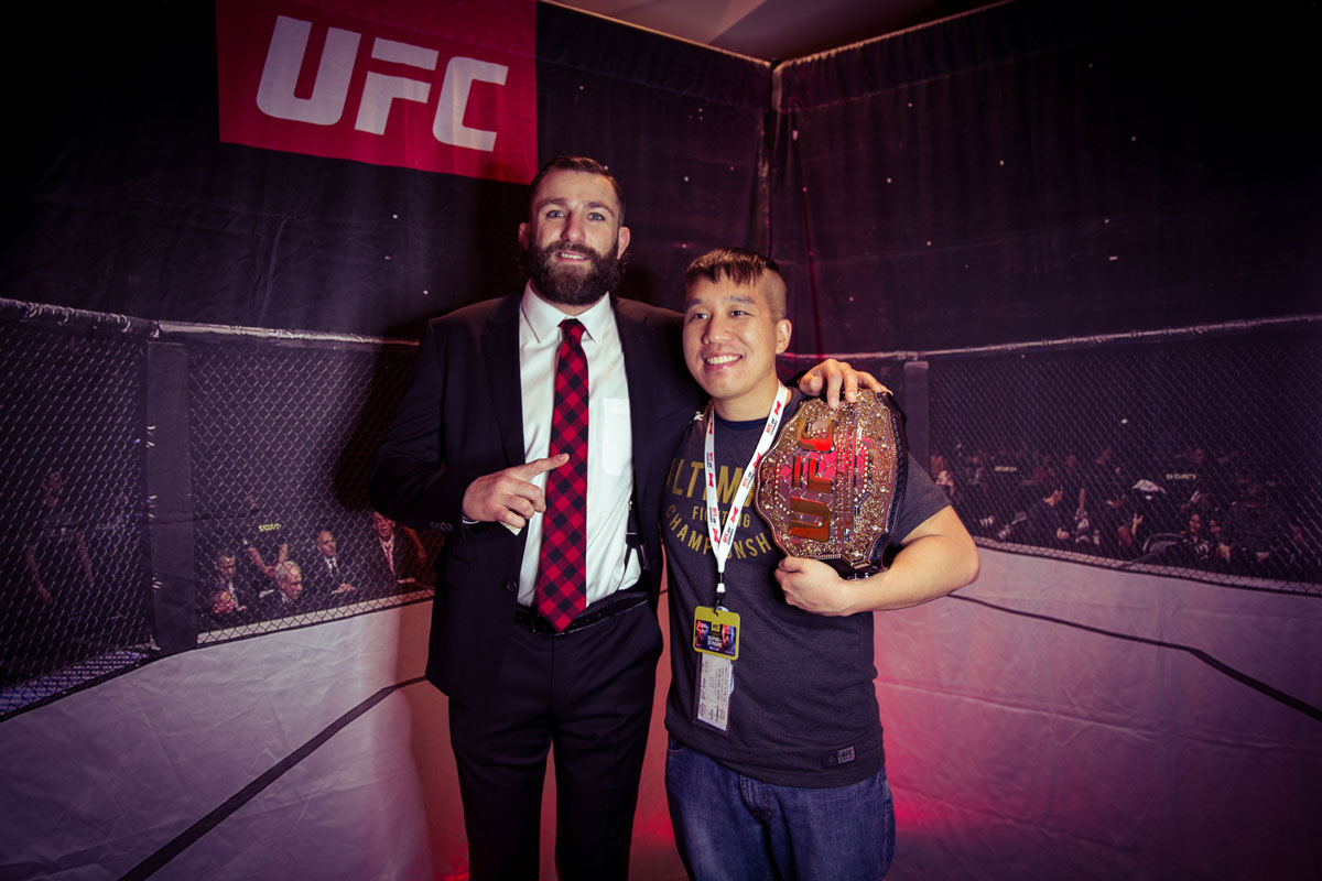 photo with UFC celebrity and championship belt