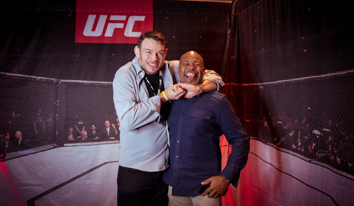 Photo with UFC fighter in UFC Experiences photobooth